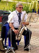 BUDYONNOVSK, STAVROPOL REGION, RUSSIA - MAY 1, 2014: saxophonist from municipal brass band on the La