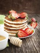 Stack Of Pancakes With Strawberry And Honey