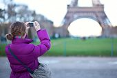 Tourist Taking A Picture Of The Eiffel Tower