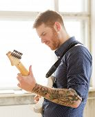 foto of ginger man  - Handsome man playing on guitar - JPG
