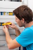 Handyman Checking Voltage