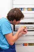 Young Repairman Checking Voltage