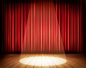 A theater stage with a red curtain and a spotlight. Vector.