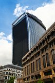 LONDON, UK - APRIL 24, 2014: Famous Walkie Talkie building still keeps iconic glass  wall cowered. W
