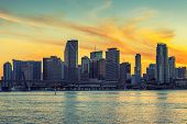 stock photo of florida-orange  - CIty of Miami Florida business and residential buildings at sunset - JPG