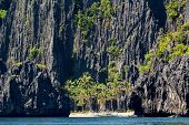 White beach and limestone cliffs in El Nido,  Philippines