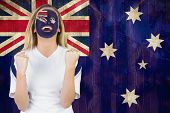 Excited australia fan in face paint cheering against australia flag in grunge effect