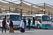 AMMAN, JORDAN - MARCH 18, 2014: People search the bus on the bus terminal Tabarbour. Public bus rout