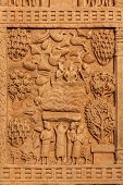 SANCHI, INDIA  - APRIL 29, 2011: Gateway decoration bas relief of Great Stupa - ancient Buddhist mon