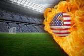 Composite image of fire surrounding usa flag football against vast football stadium with fans in blu