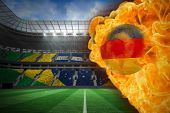 Composite image of fire surrounding germany flag football against large football stadium with brasil
