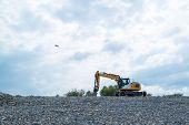 Excavator and plane