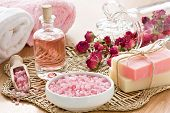 stock photo of salt-bowl  - SPA treatment set with sea salt rose aroma oil and soap bar - JPG