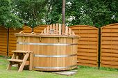 image of hot-tub  - modern new wooden water spa hot tub with stairs outdoor - JPG
