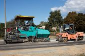 stock photo of paving  - A couple of Asphalt paving machines used in construction - JPG
