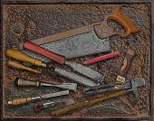 Vintage Woodworking Tools Over Rusty Plate