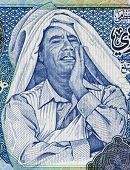 LIBYA - CIRCA 2004: Muammar Gaddafi (1942-2011) on 1 Dinar 2004 Banknote from Libya. Ruler of Libya during 1969-2011.