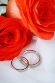 Wedding rings on wedding bouquet, close-up, on light background