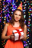 Portrait of beautiful young girl on bright lights background