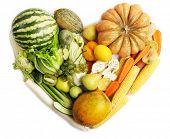 Fresh organic vegetables in shape of heart, isolated on white