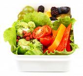 Tasty vegetarian food in plastic box, isolated on white