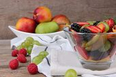 fresh tasty fruit salad on wooden table