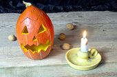 picture of repentance  - Halloween pumpkin with a candle on a wooden table - JPG