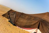 Brown Bedouin tent in the desert