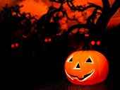 Halloween Night Background With Scary Red Eyes And Pumpkin