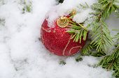 Christmas red ball in snow