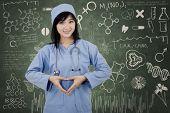 Surgeon Student Makes Heart Symbol