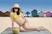 Woman Sitting Near The Beach Huts