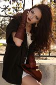 Beautiful Ladylike Woman With Dark Hair In Elegant Coat And Leather Gloves