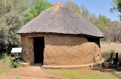 stock photo of mud-hut  - Traditional Sotho hut built by the indigenous Sotho tribe - JPG