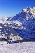 Boy On Snowboard At Winter Sport Resort In Swiss Alps
