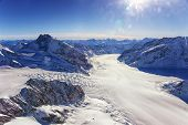 Swiss Aletch Glacier Fall Helicopter View In Winter