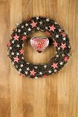 Decorated Christmas Door Wreath Gingham And Birch Stars With Tin Heart On Sapele Wood Background