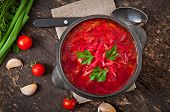 Traditional Ukrainian Russian vegetable borsch on the old wooden background