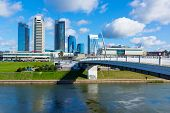 VILNIUS, LITHUANIA - SEPTEMBER 24: New modern skyscrapers on September 24, 2014 in Vilnius, Lithuania. Business Harbour is a solid business centre, remarkable of its architecture and modernity.