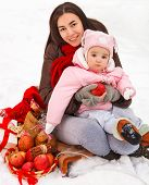Young Brunette Mother With Her Daughter Outdoors