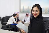 Arabian Businesswoman attending a meeting