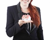 Young Business Woman Showing Mini House In Her Hand