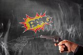 stock photo of handgun  - View of hand drawing of handguns vs real handgun on blackboard - JPG