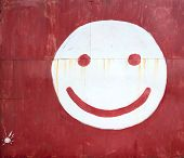 stock photo of gate  - Smiley face drawing on the metal gate - JPG