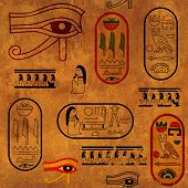 Seamless background with paper texture and Egyptian symbols