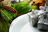 Closeup Christmas Plate Silver Gifts Pines Wooden Surface