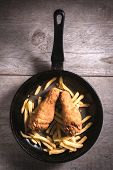 pic of gold panning  - French fries and fried chicken legs in the pan from above - JPG