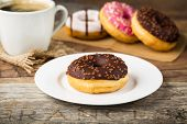 pic of donut  - tasty donut with nut-chocolate topping and fresh brewed coffee