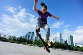 stock photo of skateboarding  - skateboarder practice skateboarding trick - JPG