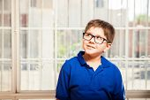 picture of daydreaming  - Creative little boy with glasses daydreaming and looking towards copy space - JPG